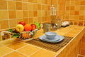 Kitchen modern table closeup with fruit and wares Royalty Free Stock Photography