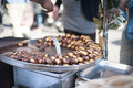 Kitchen pan and many roast chestnuts Royalty Free Stock Photo