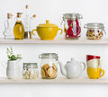 Kitchen shelves with various food ingredients and utensils on white Royalty Free Stock Photo