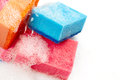 Kitchen sponges in foam on white background Royalty Free Stock Images