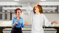 Kitchen staff young waitress and chef fighting in a Royalty Free Stock Photo