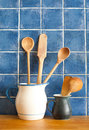 Kitchen still life. interior with retro accessories. Blue tiles ceramic wall background, pitchers vintage wooden spoons. Royalty Free Stock Photo