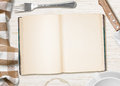 Kitchen table with open book or copybook for cooking recipe as a background Stock Image