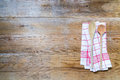 Kitchen towel background with wooden spoons red cooking on light wood Royalty Free Stock Images