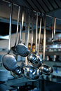 Kitchen utensil hanging on metal bar Stock Images