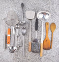 Kitchen utensil iv a collection of on granite surface Stock Photography
