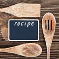 Kitchen utensils and a blackboard to write a recipe wooden Royalty Free Stock Photo