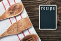 Kitchen utensils and a blackboard to write a recipe wooden Royalty Free Stock Photography