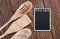 Kitchen utensils and a blackboard to write a recipe wooden Royalty Free Stock Image