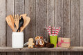 Kitchen utensils and christmas spices on shelf Royalty Free Stock Photo