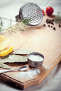 Kitchen utensils, spices and herbs for cooking fish