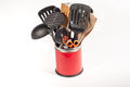 Kitchen utensils various in a red pot isolated on a white background Royalty Free Stock Photos
