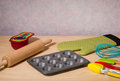 Kitchen utensils on wooden table Royalty Free Stock Photos