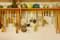 Kitchen ware hanging on the wall white Royalty Free Stock Photos