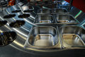Kitchen worktop a with stainless steel containers embedded in Royalty Free Stock Image
