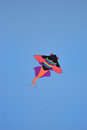 Kite in the blue sky Stock Images