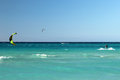 Kite boarding mans riding his kiteboard on varadero beach Stock Photos