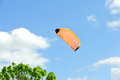 Kite flying on background of blue sky with clouds wing a Royalty Free Stock Photography
