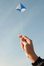 Kite flying in a blue sky and clouds Royalty Free Stock Photography