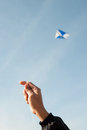Kite flying in a blue sky and clouds Stock Image