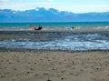 Kite sailing in alaska at low tide Royalty Free Stock Photo