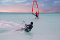 Kite surfer on Aruba in the Caribbean at sunset Royalty Free Stock Photo