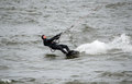 Kite surfer holds tight this dare devil in the icy november waters of lake michigan fights to hold on to his in the wild high Royalty Free Stock Photos