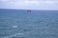 Kite surfer jumpting waves