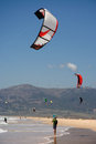 Kite surfer photographer taking pictures to sportsmen surfers on clean beach in summer day tarifa spain Stock Image