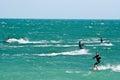 Kite surfers on a choppy sea Royalty Free Stock Photo