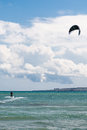 Kite surfing at sea person with white clouds in the background Stock Photography