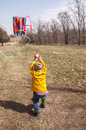 Kite wrangler boy working hard to keep a flying Royalty Free Stock Photo