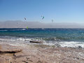 Kites in eilat red sea israel windsurfers and on the beach of Royalty Free Stock Photography