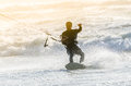 Kitesurfer in action on a beautiful background of spray during the sunset Royalty Free Stock Photo
