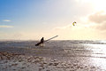 Kitesurfer on beach in waves Royalty Free Stock Photo