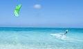 Kitesurfer on clear blue tropical lagoon water okinawa japan man enjoying kitesurfing sea kume island Royalty Free Stock Image