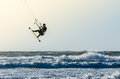 Kitesurfer jumping on a beautiful background of spray during the sunset Royalty Free Stock Images
