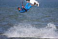 Kitesurfer jumping on the sea Royalty Free Stock Photos