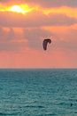 Kitesurfer on mediterranean sea at sunset in israel vertical image of glides wavy water surface against background of beautiful Stock Photos
