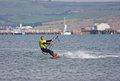 Kitesurfer sailing in portland harbour Stock Photos