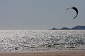 Kitesurfer sailing in swansea bay Royalty Free Stock Photos