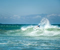Kitesurfer sportsman makes acrobatic trick on big sea wave Royalty Free Stock Photo