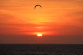 Kitesurfer at sunset on the sea Royalty Free Stock Photo