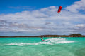 Kitesurfer surfing in the lagoon of la mer d emeraude north of madagascar Royalty Free Stock Photography