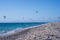 Kitesurfers on the beach in Greece Royalty Free Stock Photo