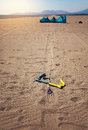 Kitesurfers on the beach prepare sport equipment for riding Royalty Free Stock Photo