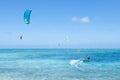 Kitesurfers on clear blue tropical lagoon water okinawa japan men enjoying kitesurfing sea kume island Stock Images
