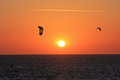 Kitesurfers at sunset on the sea Royalty Free Stock Image