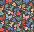 Kitschy background seamless pattern with butterflies flowers and hearts Royalty Free Stock Image