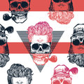 Kitschy seamless pattern. Human skulls with hipster hairstyle and smoking pipe drawn in engraving style against red